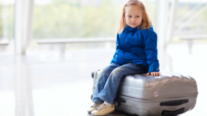 kid on suitcase