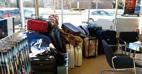 Kennys Lakes Area Auto Experts luggage drive for foster kids